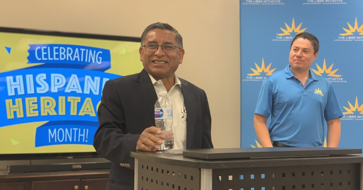 Carlos Castro speaks to LIBRE activists at an Immigrant Heritage Month event